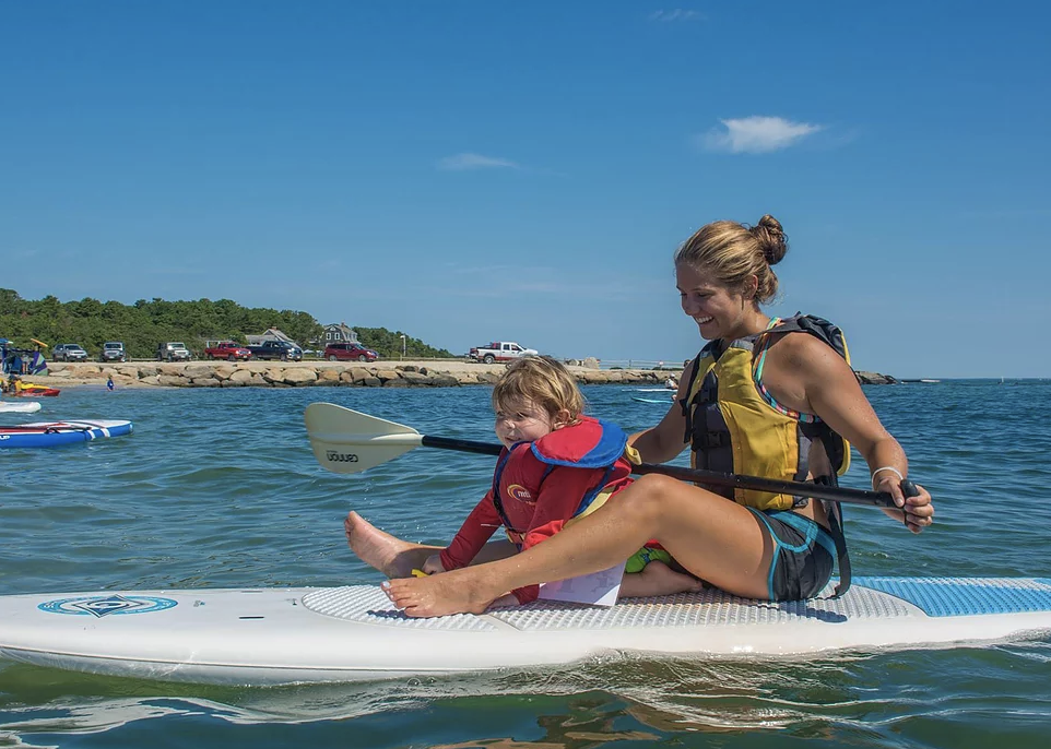 Kid and mom paddleboarding on Martha's Vineyard